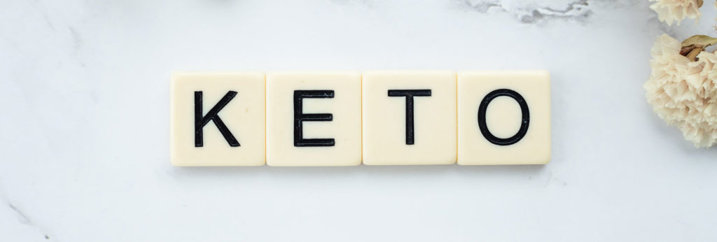 Keto in Scrabble letters on a marble floor